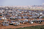 "View of the shantytown called ""Silvertown"", near Soweto, outside Johannesburg, South Africa. Architecture. Menzel's Material World Project."