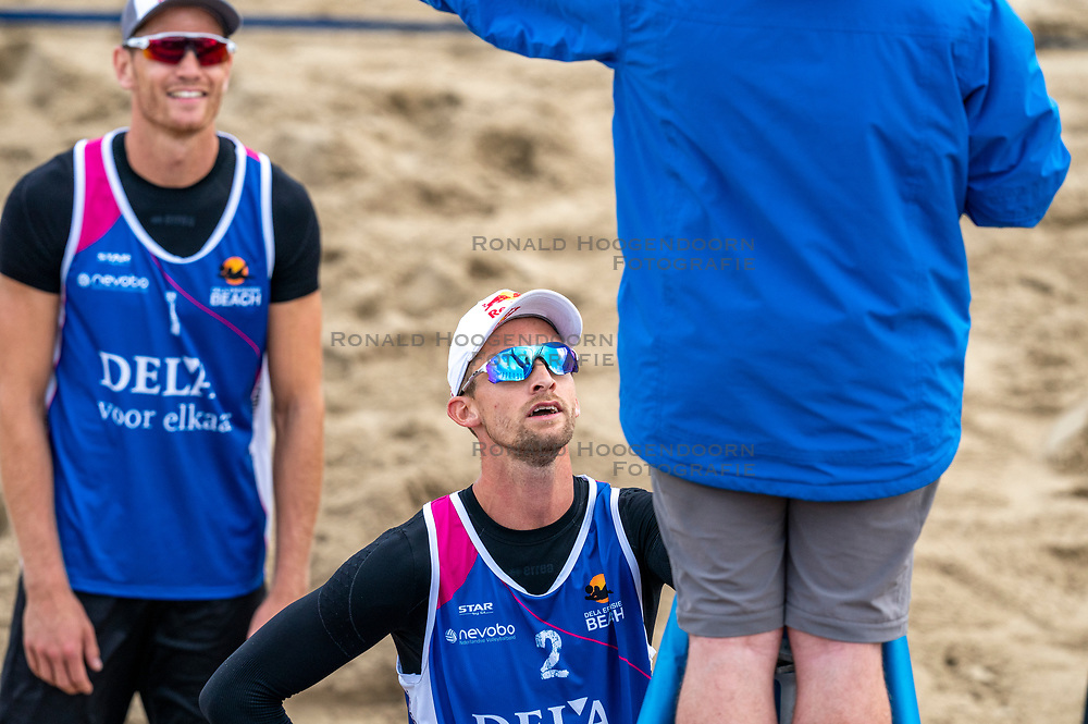 Robert Meeuwsen in discuss with the referee. The Final Day of the DELA NK Beach volleyball for men and women will be played in The Hague Beach Stadium on the beach of Scheveningen on 23 July 2020 in Zaandam.