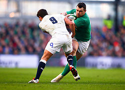 Ireland's Cian Healy is tackled by England's Ben Youngs - Photo mandatory by-line: Ken Sutton/JMP - Mobile: 07966 386802 - 01/03/2015 - SPORT - Rugby - Dublin - Aviva Stadium - Ireland v England - Six Nations