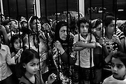 """Athens, Greece - A group of immigrants waiting for the gate opening of the Municipal soup kitchen. In 2010, according to official figures, about 133 000 migrants were apprehended illegally crossing into Greece (by land and sea). The number fell in 2011 (81 000 apprehensions in the first ten months). Since 2010, most apprehensions have occurred at the land border with Turkey. (source: Organisation for Economic Co-operation and Development - OECD). Greek economical crisis started in 2008. The so-called Austerity measures imposed to the country by the """"Troika"""" (European Union, European Central Bank, and International Monetary Fund) to reduce its debt, were followed by a deep recession and the worsening of life conditions for millions of people. Unemployment rate grew from 8.5% in 2008 to 25% in 2012 (source: Hellenic Statistical Authority).<br /> Bruno Simões Castanheira"""