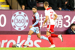 Aaron Lennon of Burnley takes on Konstantinos Tsimikas of Olympiakos - Mandatory by-line: Robbie Stephenson/JMP - 30/08/2018 - FOOTBALL - Turf Moor - Burnley, England - Burnley v Olympiakos - UEFA Europa League Play-offs second leg