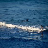 USA, California, Encinitas. Surfer at Beacon's Beach, Leucadia (Encinitas).
