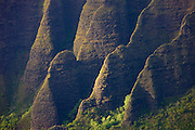 The Kalalau Valley on the island of Kauai, Hawaii is bordered by towering cliffs, about 4,000 feet fall. The low-angled light of the nearly setting sun brings out the texture on one of the valley's walls.