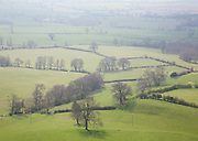 Patchwork of green fields in haze viewed from the top of the Tyndale Monument, Gloucestershire