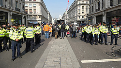 "© Licensed to London News Pictures. 17/04/2019. LONDON, UK.  Police officers gathered at Oxford Circus during ""London: International Rebellion"", on day three of a protest organised by Extinction Rebellion, demanding that governments take action against climate change.  Marble Arch, Oxford Circus, Piccadilly Circus, Waterloo Bridge and Parliament Square have been blocked by activists in the last three days.  Police have issued a section 14 order requiring protesters to convene at Marble Arch only so that the protest can continue.  Photo credit: Stephen Chung/LNP"