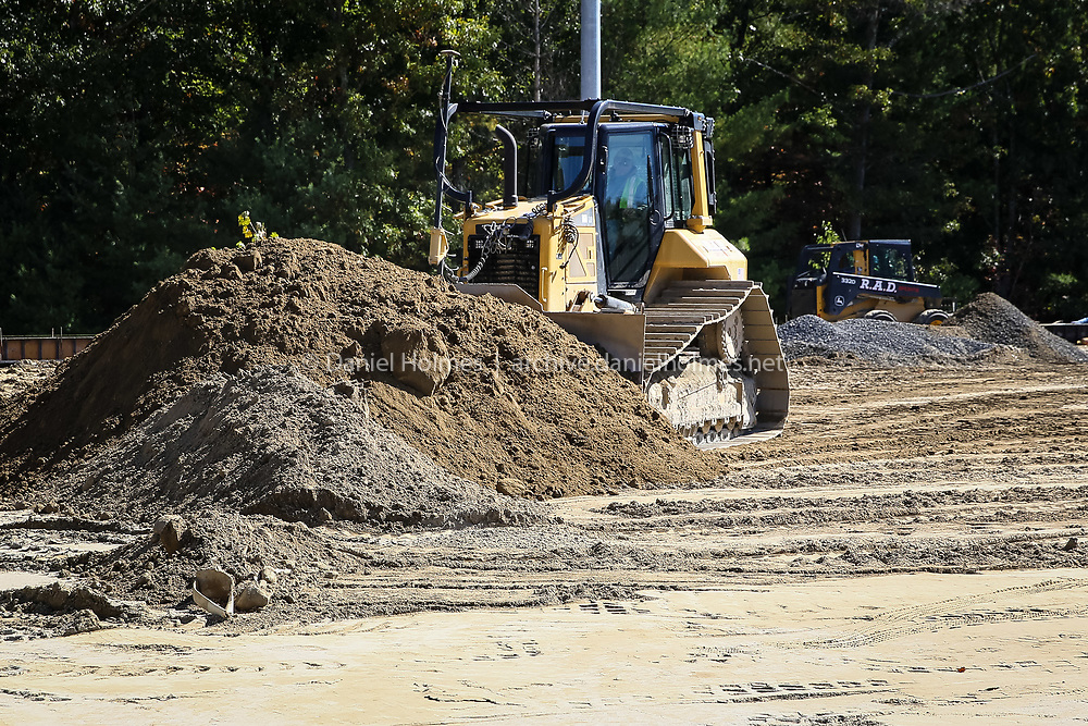 (10/6/14, MEDWAY, MA) A bulldozer works on the new playing fields at Medway High School on Monday. Daily News and Wicked Local Photo/Dan Holmes