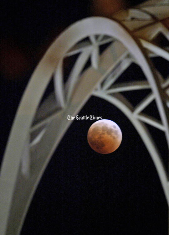 The lunar eclipse as seen through arches at the Pacific Science Center. (Rod Mar / The Seattle Times, 2004)