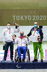TOKYO, JAPAN - SEPTEMBER 01: Silver medalist Vasyl Kovalchuk of Ukraine, gold medalist Dragan Ristic of Serbia and bronze medalist Francek Gorazd Tirsek - Nani of Slovenia celebrate at Victory ceremony after  the R5 - Mixed 10m Air Rifle Prone SH3 Final on day 8 of the Tokyo 2020 Paralympic Games at Asaka Shooting Range on September 01, 2021 in Asaka, Japan.  Photo by Vid Ponikvar / Sportida