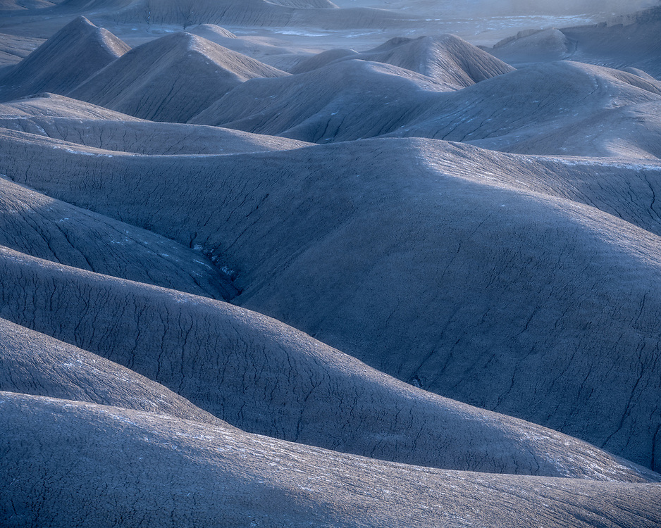 Soft evening light on the erroded badlands and dunes in the San Rafael Swell in Southern Utah, USA