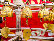 """27 NOVEMBER 2012 - BANGKOK, THAILAND:  Prayer bells inscribed """"Golden Mount Thailand"""" at the Wat Saket Temple Fair in Bangkok. Wat Saket, popularly known as the Golden Mount or """"Phu Khao Thong,"""" is one of the most popular and oldest Buddhist temples in Bangkok. It dates to the Ayutthaya period (roughly 1350-1767 AD) and was renovated extensively when the Siamese fled Ayutthaya and established their new capitol in Bangkok. The temple holds an annual fair in November, the week of the full moon. It's one of the most popular temple fairs in Bangkok. The fair draws people from across Bangkok and spills out in the streets around the temple.   PHOTO BY JACK KURTZ"""