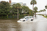 A postal delivery van pass through floodwaters along Murray Blvd in the historic district after record breaking storms dumped more than two feet of rain on the lowcountry October 5, 2015 in Charleston, South Carolina.