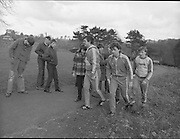 Ireland Soccer Team Training.1983.14.11.1983.11.14.1983.14th November 1983..The Ireland Soccer team trained, for the forthcoming match against Malta, at Stewarts Hospital,Palmerstown Dublin..The trek up the hill is hard work for both manager and players alike as fans hope for a word.