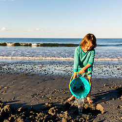 A young girl plays at Seapoint Beach in Kittery, Maine.