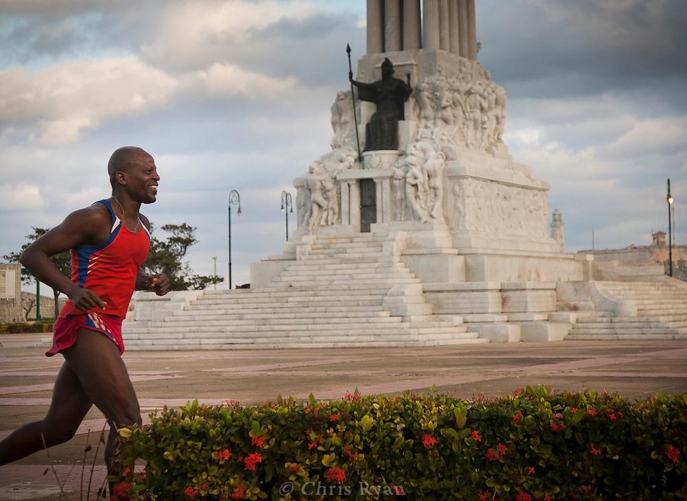 Cuban runner doing laps around monument to Maximo Gomez, Havana, Cuba