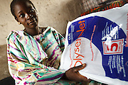 Kegneba Diakite, 28, 6 mo pregnant, holds a brand new treated mosquito net during a prenatal consultation in the village of Banankoro, Mali on Saturday August 28, 2010. Pregnant women receive a treated net on their first prenatal consultation..