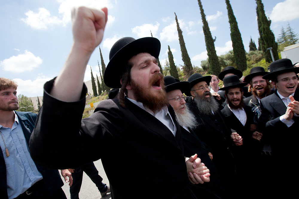 Ultra-Orthodox Jewish men dance outside the Supreme Court in Jerusalem, on June 27, 2010, following a decision to free a group of Ashkenazi parents which refused the integration and were sent to jail at the end of a discussion regarding the segregation between Ashkenazi and Sephardic Jewish girls at the Beit Yaakov school in Immanuel.