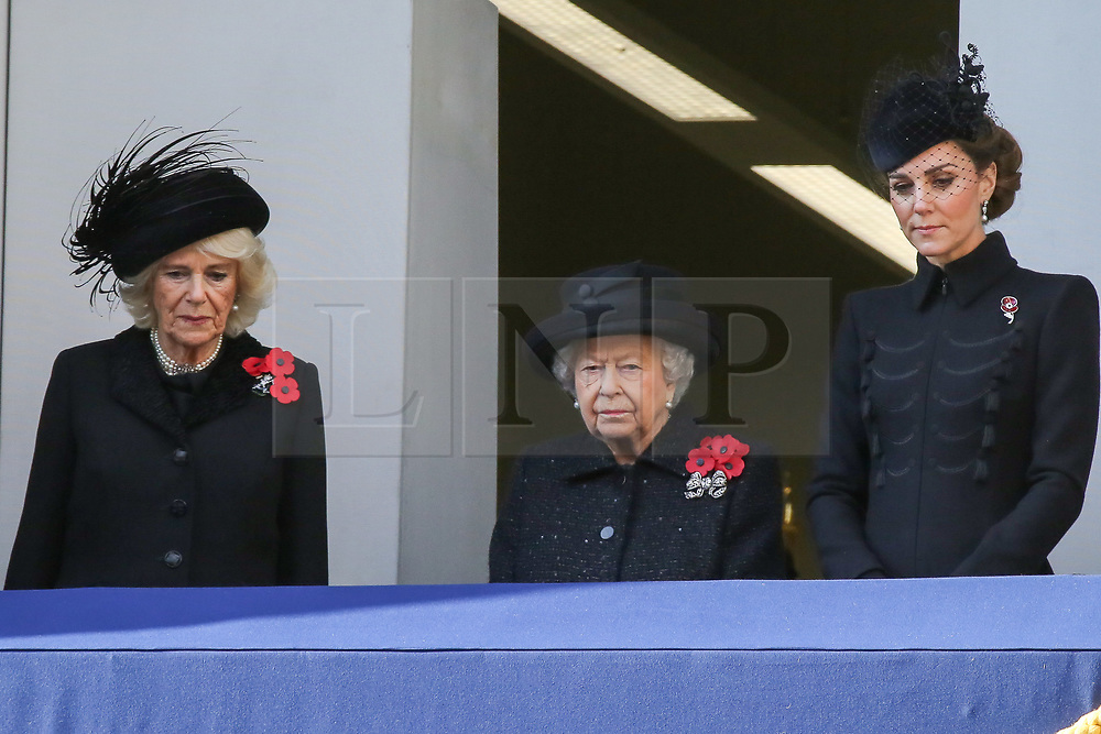 © Licensed to London News Pictures. 10/11/2019. London, UK.Camilla, Duchess of Cornwall (L), Queen Elizabeth II  and Catherine, Duchess of Cambridge attend the Remembrance Sunday ceremony at the Cenotaph memorial in Whitehall, central London. Remembrance Sunday is held each year to commemorate the service men and women who fought in past military conflicts. Photo credit: Dinendra Haria/LNP