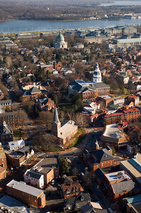 This Aeriel view of Historic Annapolis, Maryland USA, includes, St. Annes church, center, the Maryland State House, right center and The United States Naval Academy, top. The Maryland State House is the oldest state house still in legislative use. It was designated a National Historic Landmark in 1960.