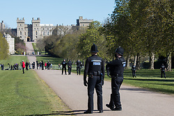 Windsor, UK. 17th April, 2021. Thames Valley Police officers conduct a security sweep of the areas of Windsor Great Park alongside the Long Walk on the day of the funeral of the Duke of Edinburgh. The funeral of Prince Philip, Queen Elizabeth II's husband, is taking place at St George's Chapel in Windsor Castle, with the ceremony restricted to 30 mourners in accordance with current coronavirus restrictions.