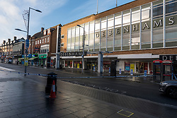 © Licensed to London News Pictures. 14/12/2020. HARROW, UK. Cordons outside Debenhams in Station Road. A man, believed to be in his 20s, has died and two others, believed to be in their late-teens, have been injured in a stabbing Station Road in Harrow, north west London. The Met Police said emergency services were called to the area at 19:15 GMT on Sunday 13 December to reports of a stabbing.  A crime scene remains in place.  Photo credit: Stephen Chung/LNP