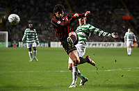 Photo: Paul Thomas.<br /> Glasgow Celtic v AC Milan. UEFA Champions League. Last 16, 1st Leg. 20/02/2007.<br /> <br /> Kenny Miller (R) of Celtic has Kakha Kaladze of Milan clear the ball from in front of him.