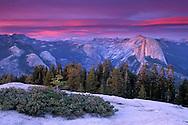 Alpenglow on clouds at sunset above Half Dome and Tenaya Canyon, Yosemite National Park, CALIFORNIA