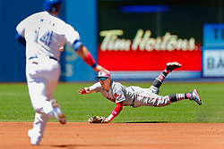 May 13, 2018 - Toronto, ON, U.S. - TORONTO, ON - MAY 13: Boston Red Sox Shortstop Xander Bogaerts (2) makes a diving leap to catch and toss the ball to his teammate second baseman Brock Holt (12) to get out approaching runner Toronto Blue Jays First base Justin Smoak (14) in the 1st inning during the MLB game between the Boston Red Sox and the Toronto Blue Jays on May 13, 2018 at Rogers Centre in Toronto, ON. (Photo by Jeff Chevrier/Icon Sportswire) (Credit Image: © Jeff Chevrier/Icon SMI via ZUMA Press)