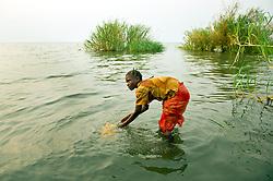 Girls gather water in the village of Nkonkwa, on Lake Tanganyika in Tanzania August 25, 2011. Ami Vitale