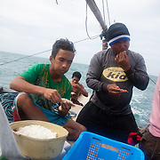 Breakfast time, the crew munches on shell fish in various forms and sizes. Joseph is 17 and works like his father did on the sea as a fisherman. The catch of the day is hauled in by the entire crew to be sorted out on deck and taken straight to the market in Hinigaran. The catch that day made the crew $12.00 each( Captain Joan $24.00) One day a week Joseph goes to Alternative Learning schooling provided by Quidan-Kaisahan.  Quidan-Kaisahan is a charity working in Negros Occidental in the Philippines. Their aim is to keep children out of work to secure them education.