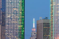 Mercantile Building clock and downtown dallas skyscrapers at night, Dallas, Texas, USA.
