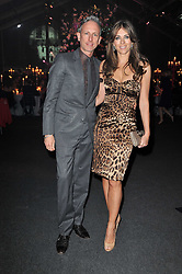 ELIZABETH HURLEY and PATRICK COX at the KIDS 40th Birthday Gala Dinner held in the Boiler House at Battersea Power Station, London on 10th March 2011.