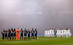 Paris Saint-Germain and Real Madrid players observe a minutes silence in memory of Davide Astori before the UEFA Champions League match at Parc des Princes