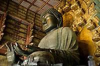 "The Great Buddha of Nara belongs to Todaiji Temple, located in the ancient capital of Nara.  The construction of Todaiji, was completed in 752 with the aim, not only to house the Great Buddha image, but also to consolidate the position of the city as Japan's capital and powerful center of Buddhism. The Great Buddha Hall, called ""Daibutsu-Den"", the main hall of Todaiji, was rebuilt several times. The current structure, completed in 1709, is only two-thirds of the original size, but is still the largest wooden building in the world. The seated figure inside is the world's largest bronze image of Buddha. The Historic Monuments of Ancient Nara were registered as UNESCO World Cultural Heritage site."