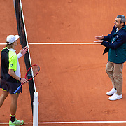PARIS, FRANCE October 01. Denis Shapovalov of Canada argues a line call with chair umpire Carlos Ramos during his match against Roberto Carballes Baena of Spain in the second round of the singles competition on CourtSuzanne Lenglen during the French Open Tennis Tournament at Roland Garros on October 1st 2020 in Paris, France. (Photo by Tim Clayton/Corbis via Getty Images)