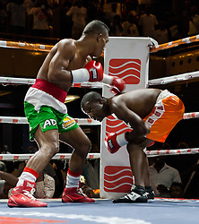 Zimbabwe boxer Charles Manyuchi ducks a blow from Jose Agustine Feria of Colombia in an international non title welterweight fight , the match ended in a TKO during the first round, October 15 2016. Photo/Jekesai Njikizana.
