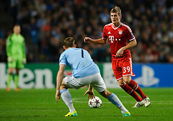 Bayern Midfielder Toni Kroos (GER) is challenged by Man City Midfielder James Milner (ENG) during the second half of the match - Photo mandatory by-line: Rogan Thomson/JMP - Tel: Mobile: 07966 386802 - 02/10/2013 - SPORT - FOOTBALL - Etihad Stadium, Manchester - Manchester City v Bayern Munich - UEFA Champions League Group D.