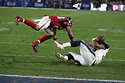Los Angeles Rams running back Todd Gurley II (30) is covered by diving Atlanta Falcons cornerback Robert Alford (23) on a late second quarter pass reception reviewed and reversed as an incomplete pass near the Falcons goal line during the 2018 NFC Wild Card NFL playoff football game against the Atlanta Falcons, Saturday, Jan. 6, 2018 in Los Angeles. The Falcons won the game 26-13. (©Paul Anthony Spinelli)