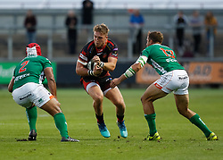 Dragons' Tyler Morgan under pressure from Benetton Treviso's Epalahame Faiva<br /> <br /> Photographer Simon King/Replay Images<br /> <br /> Guinness PRO14 Round 1 - Dragons v Benetton Treviso - Saturday 1st September 2018 - Rodney Parade - Newport<br /> <br /> World Copyright © Replay Images . All rights reserved. info@replayimages.co.uk - http://replayimages.co.uk
