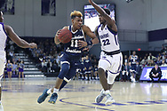 HIGH POINT, NC - JANUARY 06: Charleston Southern's Christian Keeling (11) and High Point's Andre Fox (22). The High Point University of Panthers hosted the Charleston Southern University Buccaneers on January 6, 2018 at Millis Athletic Convocation Center in High Point, NC in a Division I men's college basketball game. HPU won the game 80-59.