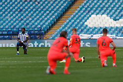 Dominic Iorfa of Sheffield Wednesday takes a knee before the match - Mandatory by-line: Daniel Chesterton/JMP - 24/06/2020 - FOOTBALL - Hillsborough - Sheffield, England - Sheffield Wednesday v Huddersfield Town - Sky Bet Championship
