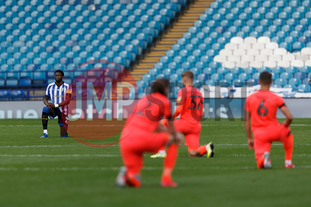 Dominic Iorfa of Sheffield Wednesday takes a knee before the match - Mandatory by-line: Daniel Chesterton/JMP - 24/06/2020 - FOOTBALL - Hillsborough - Sheffield, England - Sheffield Wednesday v Huddersfield Town - Sky Bet Championship