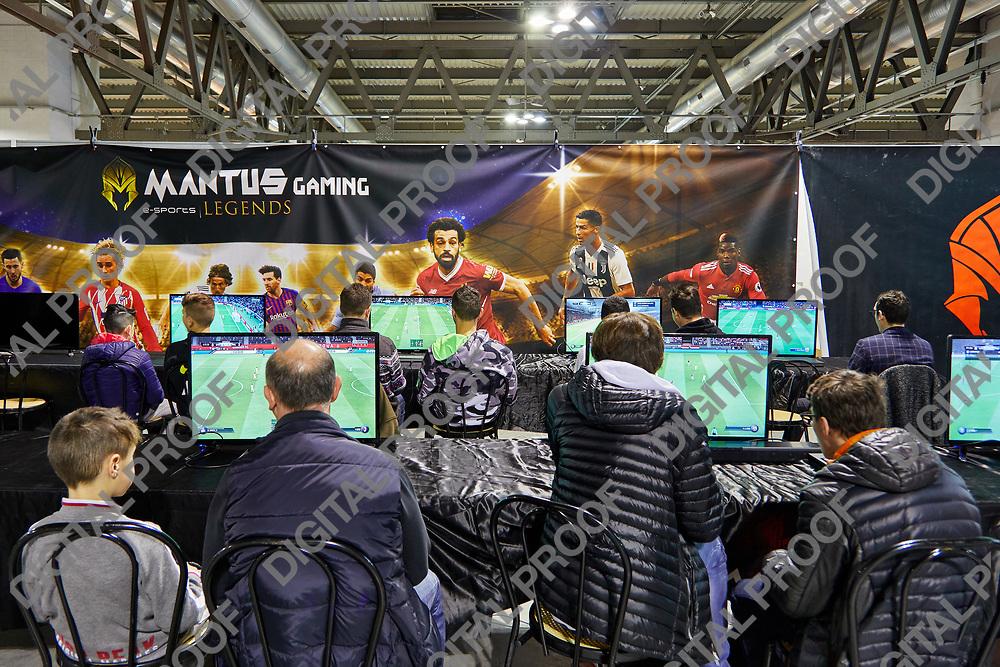 Milan, Italy - March 8 2019 Cartoomics Comic Con Visitors play FIFA 19 EA Sports game at Mantus Gaming stand