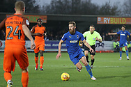 AFC Wimbledon midfielder Scott Wagstaff (7) dribbling and about to take on Southend United defender Jason Demetriou (24) during the EFL Sky Bet League 1 match between AFC Wimbledon and Southend United at the Cherry Red Records Stadium, Kingston, England on 24 November 2018.