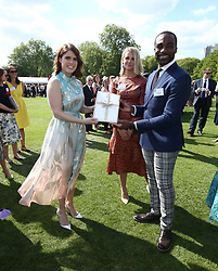 Princess Eugenie of York meeting Strictly Come Dancing winner Ore Oduba and his wife Portia, during the Duke of Edinburgh Gold Award presentations in the Buckingham Palace garden, London.