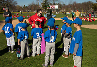 Jessica Haggett Player Agent for Laconia Little League talks with the Dental Expressions instructional team during opening day ceremonies at Colby Field Saturday.  (Karen Bobotas Photo/for The Laconia Daily Sun)