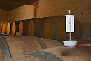 Chateau de Montpezat. Pezenas region. Languedoc. Barrel cellar. France. Europe. A measuring device to check the ullage, ouillage, the air pocket and amount of evaporation, in the oak barrel.