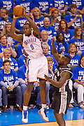 June 2, 2012; Oklahoma City, OK, USA; Oklahoma City Thunder forward Serge Ibaka (9) looks to make a pass under pressure from San Antonio Spurs center DeJian Blair (45) during a playoff game  at Chesapeake Energy Arena.  Thunder defeated the Spurs 109-103 Mandatory Credit: Beth Hall-US PRESSWIRE
