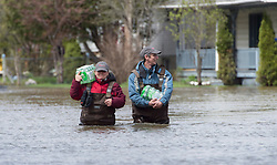 A man and woman carry bottled water into the flooded area of Gatineau, Quebec, Canada. Monday, May 8, 2017. Photo by Adrian Wyld /The Canadian Press/ABACAPRESS.COM