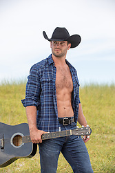hot cowboy with open shirt holding a guitar