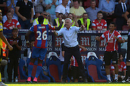 Bakary Sako of Crystal Palace celebrates after scoring his teams second goal of the match with Alan Pardew, the Crystal Palace manager on the touchline. Barclays Premier league match, Crystal Palace v Aston Villa at Selhurst Park in London on Saturday 22nd August 2015.<br /> pic by John Patrick Fletcher, Andrew Orchard sports photography.